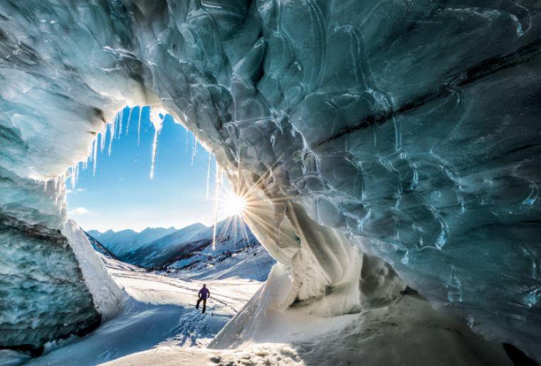 Blick aus einer Eishoehle in's Loetschental, Wallis.