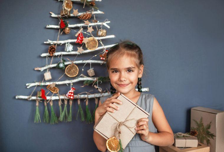 girl-near-original-christmas-tree-made-with-branch-ALFLPVU.jpg